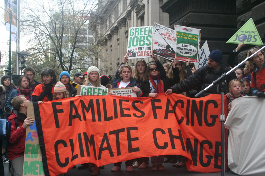 """""""Climate Emergency - Families facing Climate Change"""" by John Englart (Takver) is licensed under CC BY-SA 2.0"""